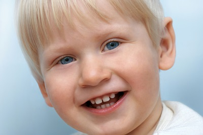 Image of a child smiling. Learn more about our child's first visit at River's Edge Dental in Great Falls, MT